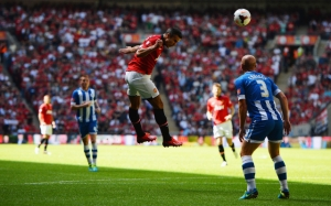 Robin Van Persie gave United a 1-0 lead with this superb header in the 7th minute.