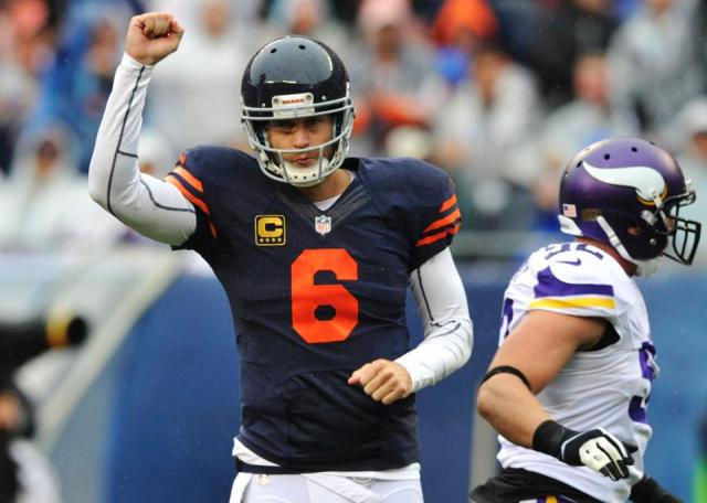 Jay Cutler celebrates a first half touchdown against the Vikings. Photo Credit: AP Photo/Jim Prisching