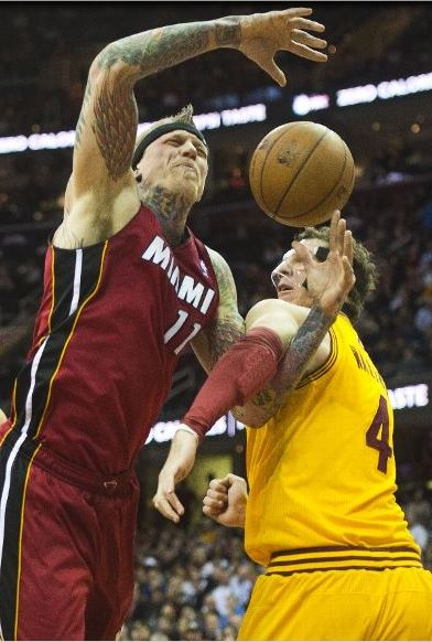 Because when you think Cavs-Heat, you think two white guys; and those white guys being Birdman and Luke Walton. (Photo by Jason Miller/Getty Images)