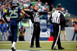 Here's referee Jeff Triplette announcing four penalties that somehow offset. Photo Credit: John Lok/The Seattle TImes