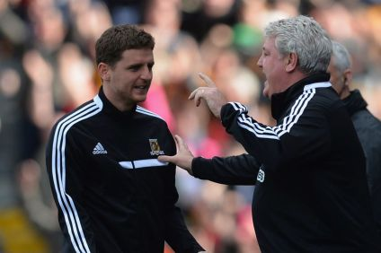 At left, Hull City defender Alex Bruce with his father and Manager, Steve.