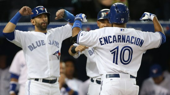 From Left: Jose Bautista, Melky Cabrera and Edwin Encarnacion celebrate following Encarnacion's grand slam this past Thursday. Photo Credit: Tom Szczerbowski/Getty Images