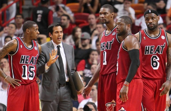 Erik Spoelstra provides instruction to his players in a game earlier this season. (Mario Chalmers on the left, Bosh, Wade and James on the right).