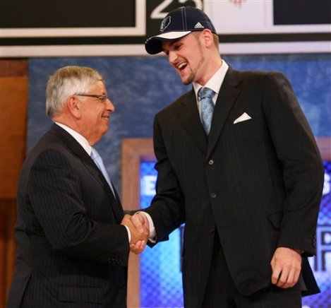 Kevin Love alongside a short and evil man named David Stern on draft day.