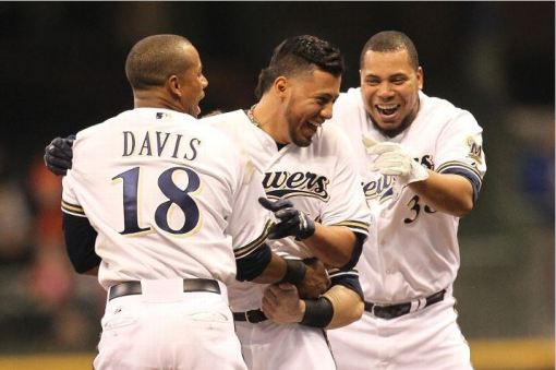 I see no reason not to end things with a smile. Yovani Gallardo is mobbed by his teammates after the Brewers' 7-6 win over Baltimore. Photo Credit: Mike McGinnis/Getty Images