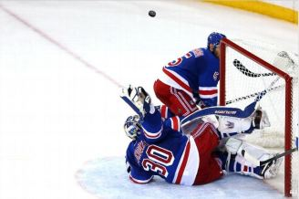 This was one of Henrik Lundqvist's 18 saves in Game 6 against the Canadiens. Oh, and he did not allow a goal. Photo Credit: Elsa/Getty Images