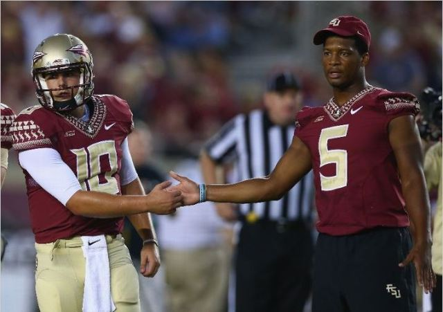 Arguably one of the biggest wins of the year for Florida State didn't even feature Jameis Winston as he was suspended for the Seminoles 23-17 victory over Clemson. He's pictured here with that quarterback that night, Sean Maguire. Photo credit to Ronald Martinez/Getty Images.