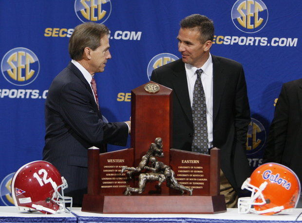 Nick Saban and Urban Meyer will rekindle an old rivalry from their days when Meyer was in charge of the Florida Gators. Photo courtesy of the AP.