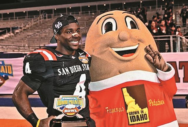 Most of you were likely  not as lucky as I was growing up to have a stuffed version of Spuddy Buddy, the mascot of the Famous Idaho Potato Bowl. Here he is following last year's game.