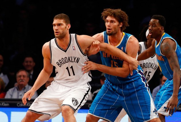 Brook Lopez, left, is defended by his brother Robin in a March 12, 2013 game. Robin has since departed New Orleans, but he and his brother make up the best pair of twins in the NBA today.