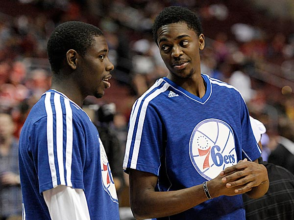 In the dying stages of the 2012-13 season, Jrue, left, and Justin Holiday had the opportunity to play together on the Philadelphia 76ers. Photo credit to Michael Perez/AP.