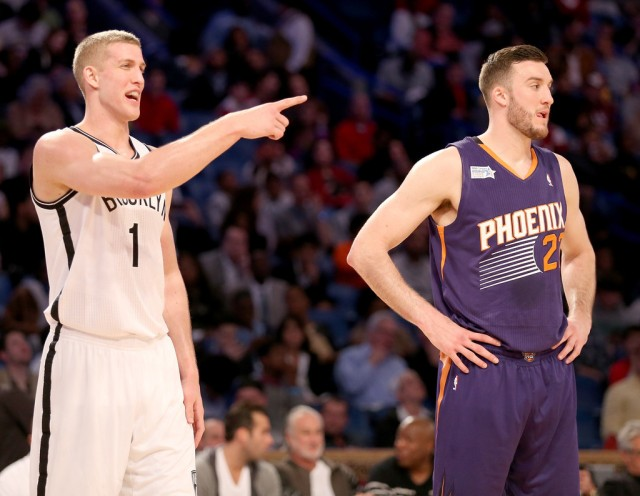 Once teammates at Duke, Mason, left, and Miles Plumlee are now making a mark in the NBA playing on opposite coasts. Photo credit to Christian Petersen/Getty Images North America.