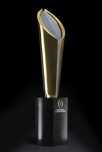This will be the first year that this National Championship Trophy will be awarded. The trophy was created by international design consultancy Pentagram and commissioned and handcrafted by Polich Tallix, a master fine art foundry in Rock Tavern New York. The trophy is made from 24-karat gold, bronze and stainless steel and measures 26.5 inches tall, weighing 35 pounds. The base of the trophy is 12 inches tall and weighs 30 pounds, resulting in a total weight of 65 pounds.