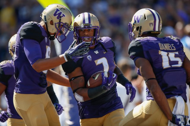 Okay in order to make sure this post isn't all text, here's Shaq Thompson and some of his UW teammates. I'll make no bones about it -- I hope they win.
